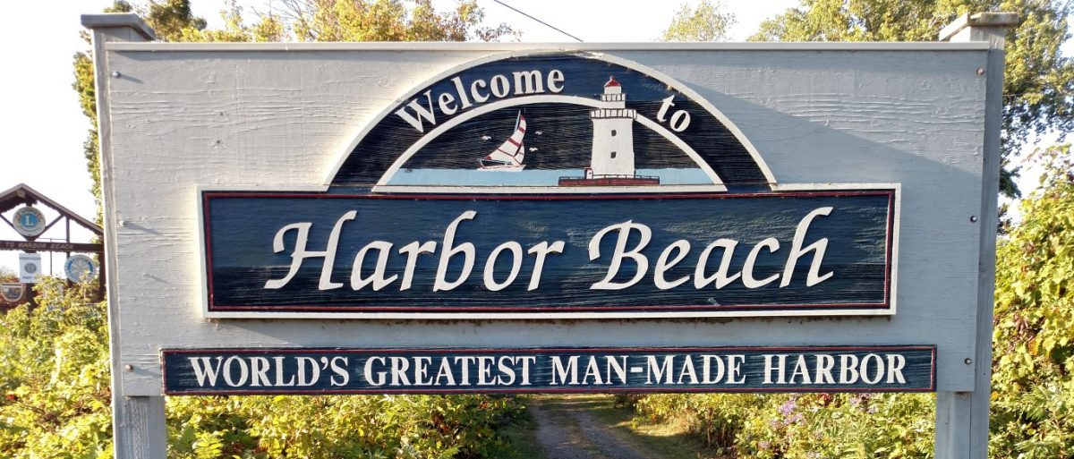 image of welcome to harbor beach, mi sign
